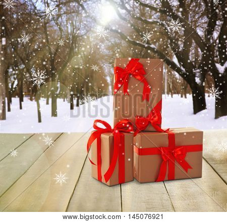 Beautiful gifts with bows on winter background with shabby table