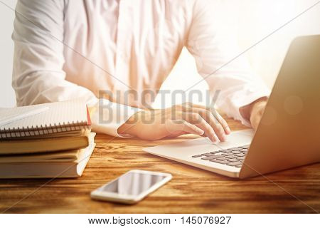 Man using modern laptop at table