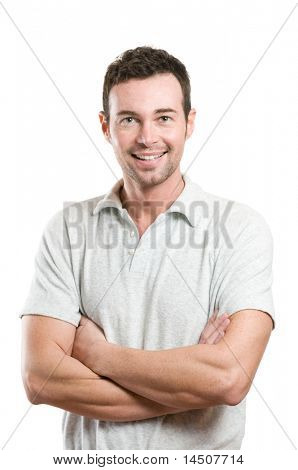 Smiling young casual man looking at camera with joy and confidence, isolated on white background