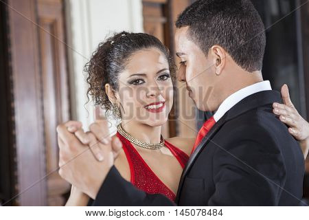 Smiling Tango Dancer Performing Gentle Embrace Step With Man
