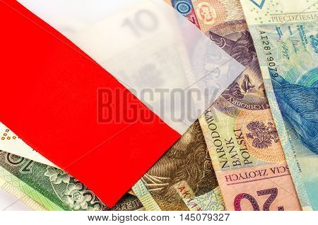 Polish zloty. Many banknotes of different denomination and the polish flag.