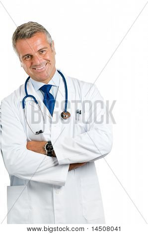 Smiling mature doctor leaning on wall isolated on white background