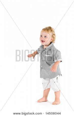 Beautiful little kid standing in equilibrium for his first steps isolated on white background