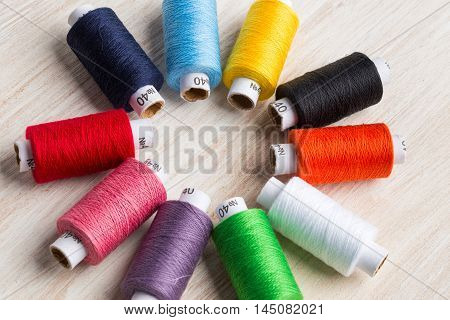 Bobbins Threads Multicolored. Old Sewing Tools On The Wooden Background.