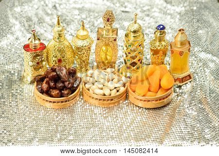 Eid and Ramadan theme backgrounds with perfume bottles and nuts and vibrant colored backgrounds