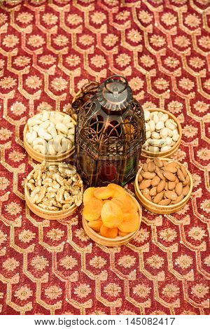 Eid and Ramadan theme backgrounds with lanterns and nuts and vibrant colored backgrounds