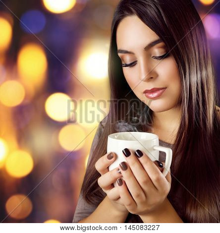 Portrait of pretty woman with cup of coffee on blurred background