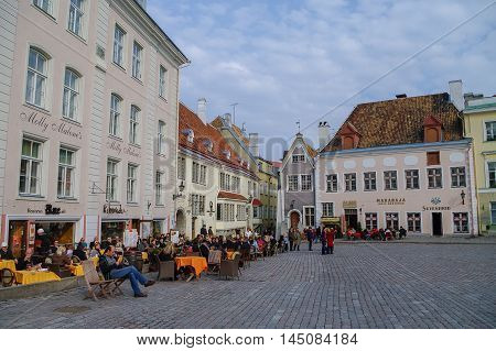 Tallinn, Estonia - March 27, 2010: Open air cafe on Town Hall Square in the center of Tallinn (Old Town). Old Town is part of the UNESCO World Heritage site