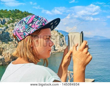 Teen Girl Photographed On A Smartphone On Vacation