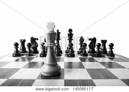 White king of deployed chess against the black pieces
