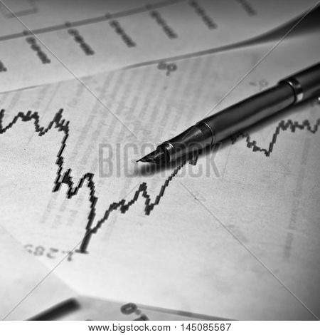 stock market graph with a pen. Business concept photo.