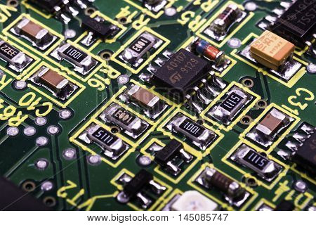 narrow cut of an electronic printed circuit board in black and white