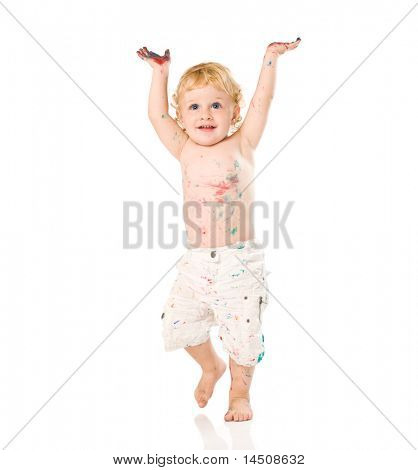 Happy jubilant beautiful child painted with colors raising arms isolated on white background