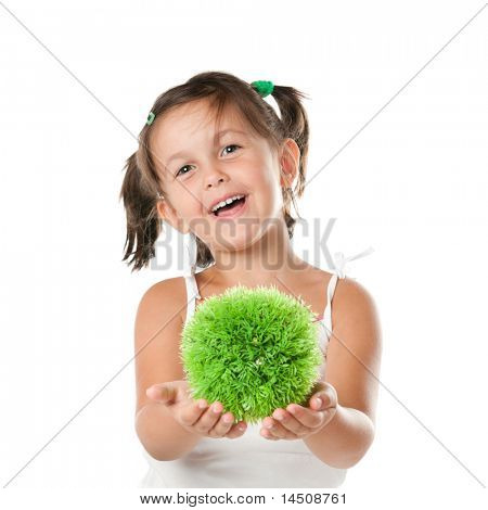 Little girl holding and offering a sphere of green grass, symbol of environmental conservation and responsibility, isolated on white background