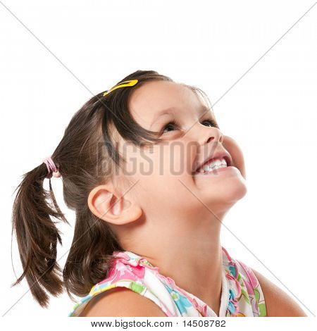 Smiling little child looking up at copyspace isolated on white background