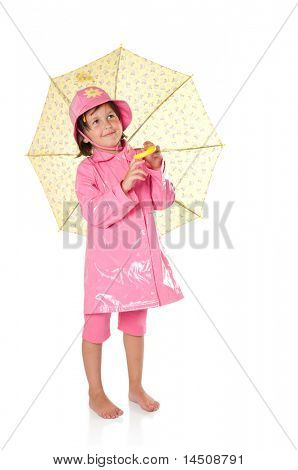 Happy little girl with raincoat and umbrella isolated on white background