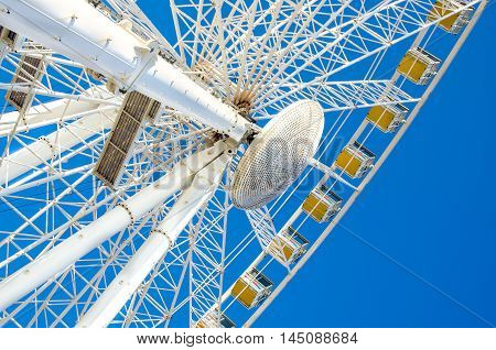 ferris wheel white blue sky background vibrant colorful