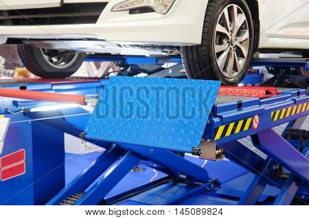 Car on a wheel alignment lift