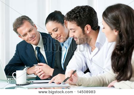 Happy smiling business team working together in a modern office
