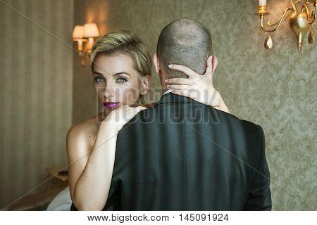 Woman Hugging A Man