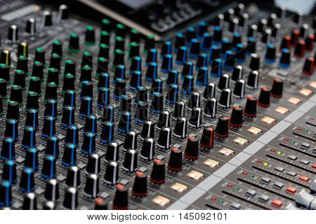 Close up view of sound mixing console. Selective focus.