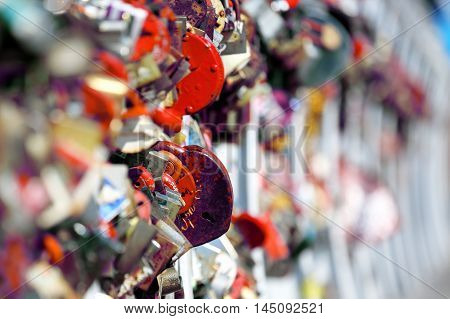 many hanging wedding locks on the bridge