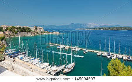 Marina with moored yachts and Old Town. View from Old Fortress of Kerkyra (Corfu town) Ionic islands Greece.