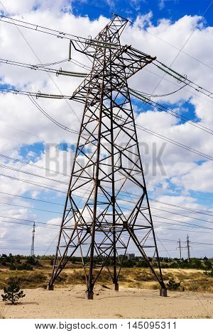 High voltage power lines 330 kV on cloudy evening sky background