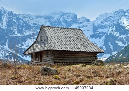 Spring mountain landscape. Wooden hut in a beautiful valley in High Tatra Mountains Poland.