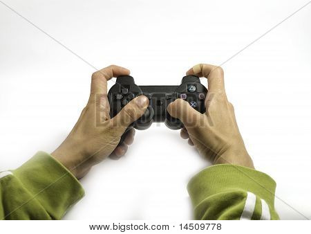 Hands With A Joystick Playing Videogame