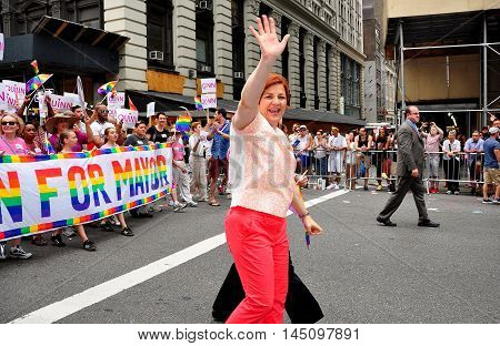 New York City - June 29 2013: Mayoral candidate Christine Quinn waves to the crowds while marching in the 2013 Gay Pride Parade on Fifth Avenue
