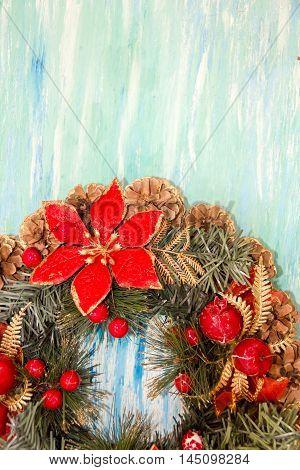 Christmas border from christmas wreath useful as christmas decoration. Christmas Greeting Card. Vintage Style. Hanging christmas decoration on wooden background.