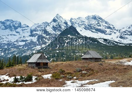 Spring mountain landscape. Wooden huts in a beautiful valley in High Tatra Mountains Poland.