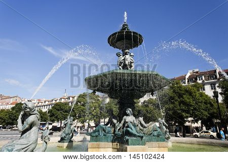 LISBON, PORTUGAL - October 15, 2015: Bronze fountain adorning Rossio Square located in the Pombaline Downtown and a main square in Lisbon, on October 15, 2015 in Lisbon, Portugal