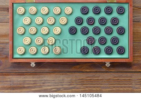 Checkers draughts in a box board on a table