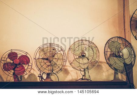 old electric fans background in vintage tone