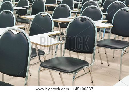 Rows of lecture chairs in a classroom