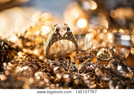 Collection of various shiny luxury golden jewelry