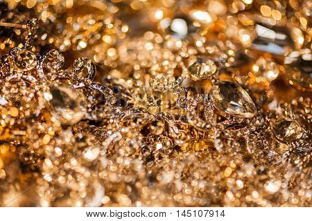 Luxury shiny precious background of close up of golden jewelry