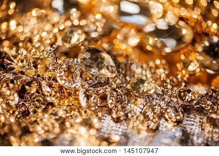 Luxury fashion precious background of golden jewelry