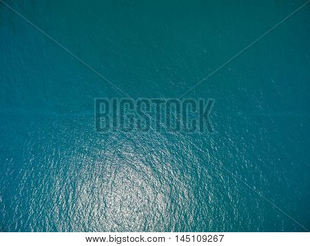 the surface of the water, turquoise in color with bird's eye