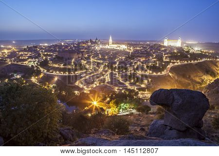 Old town cityscape with Alcazar and Cathedral at night Toledo Spain