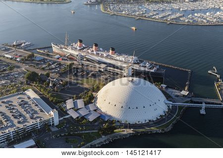 Long Beach, California, USA - August 16, 2016:  Aerial view of the historic Queen Mary and cruise ship terminal dome.