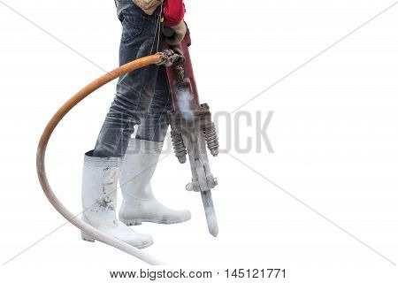Construction Worker Removes Excess Concrete With Drilling Machine In Construction Site. Isolated On