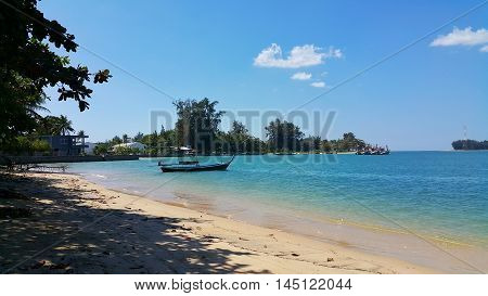 Fishing wood boat and tropical ocean view. Tropical ocean view. Wood boat and blue ocean