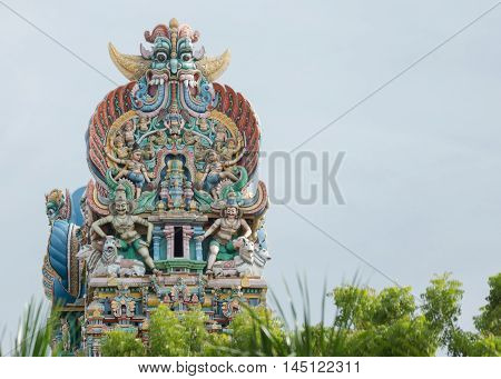 Madurai India - October 19 2013: Long shot on the top of one Vimanam on the Meenakshi Temple grounds. Detail of monster dwarapalaka bulls lions servants and more.