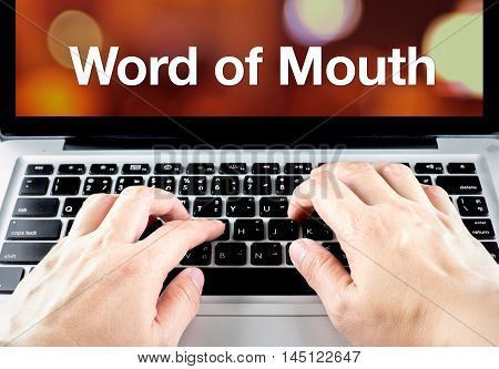 Word Of Mouth Word On Notebook Screen With Hand Type On Keyboard, Digital Marketing Concept