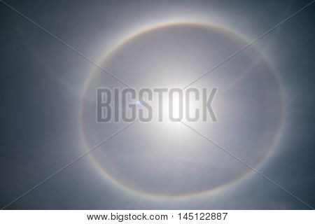 Fantastic beautiful sun halo phenomenon in one day in the summer.