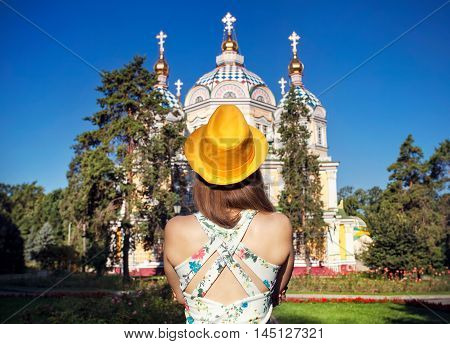 Woman In Yellow Hat Looking At Church