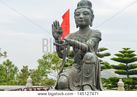 One of the Six Devas praising and making offerings to the Tian Tan Buddha.